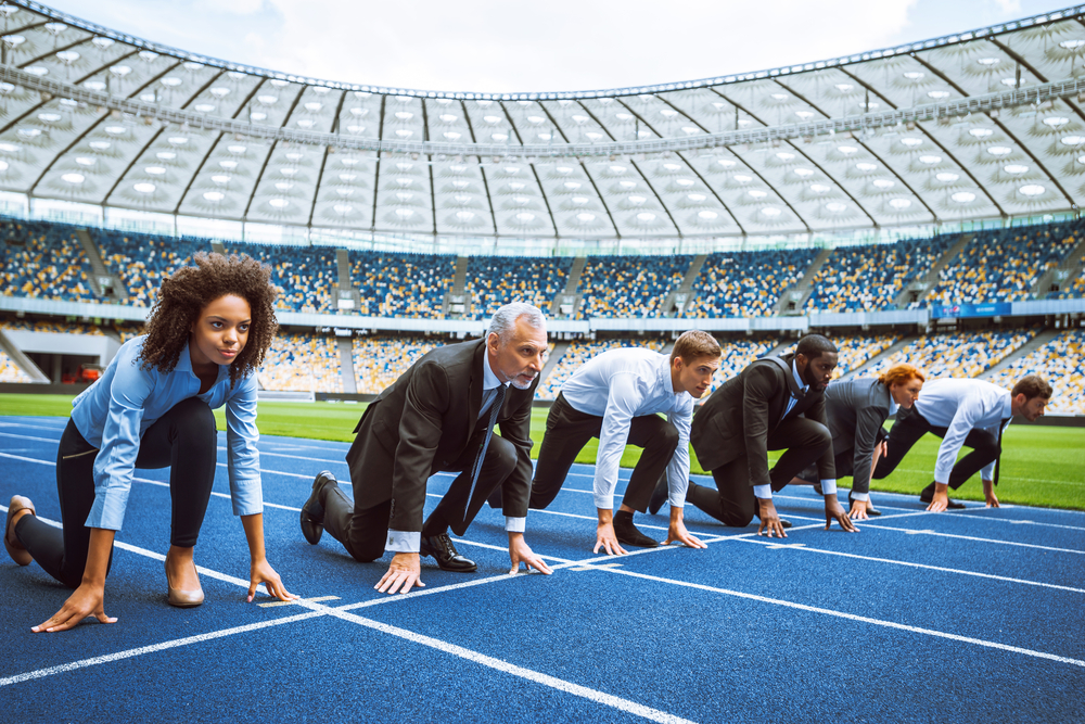 business people at the starting line of a race