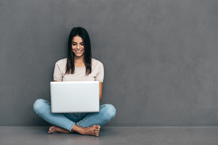 young woman sitting with laptop computer