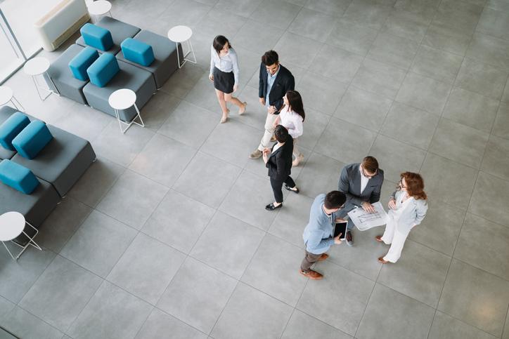 aerial view people talking in lobby setting