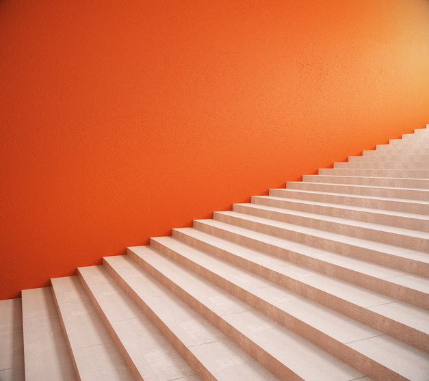 Side view of interior with bright orange wall and stairs