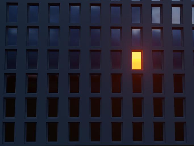 one window lit in dark building