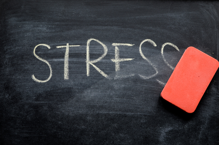 "eraser erasing the word ""stress"" on a blackboard"