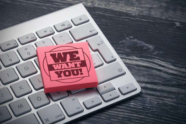 """we want you"" post-it note on keyboard"