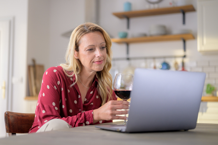 virtual meeting with a glass of win