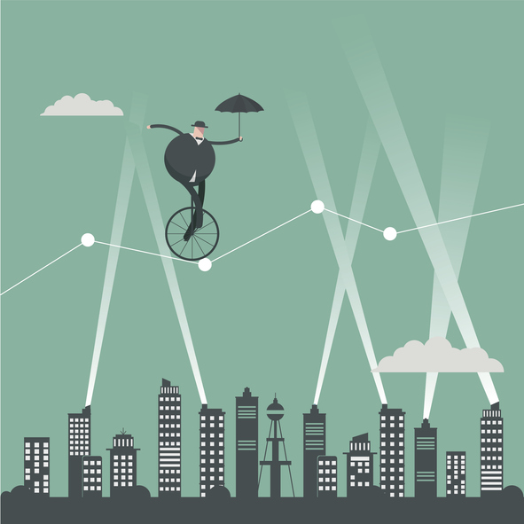 riding tight rope on bike over city