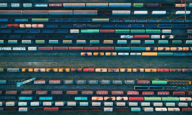 Aerial view of colorful freight trains on the railway station