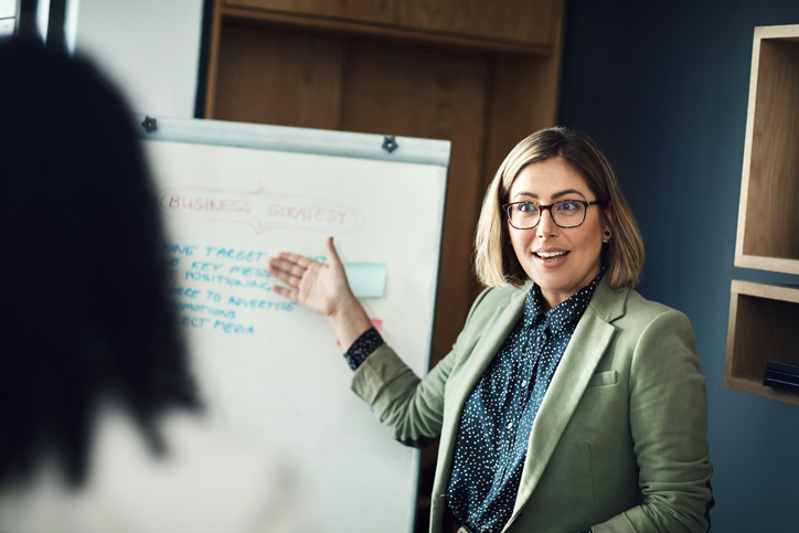 woman presenting to colleagues
